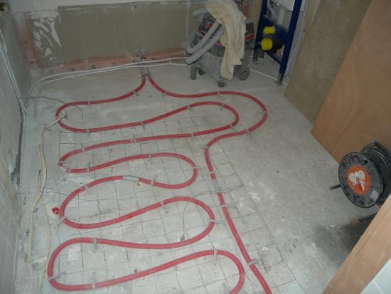aanpassing vloer verwarming en verplaatsing radiator